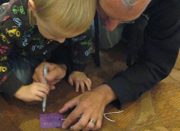 Dad and son filling out Hope Card