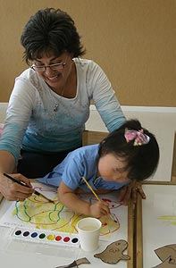 Pamela watercolor painting with child