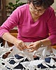 Pamela making oragami birds