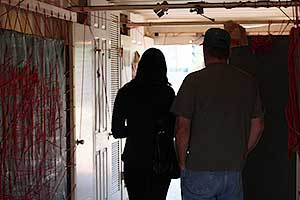 A couple in Phoenix viewing The Scarlet Cord installation