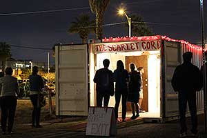 Visitors to The Scarlet Cord in Phoenix at night