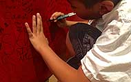 A young boy honors his hero at the ArtPrize Seven Hometown Hero exhibit