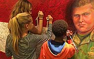 Young ArtPrize visitors write messages honoring their heroes