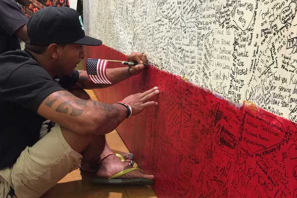ArtPrize Seven visitor writing hero message on Hometown Hero