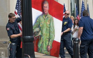 Hometown Hero being carried into the Amway Grand Plaza Hotel by Grand Rapids firefighters for ArtPrize Seven - Photo credit: Barry Southwood
