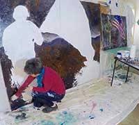 Artist Pamela Alderman while painting Hometown Hero II