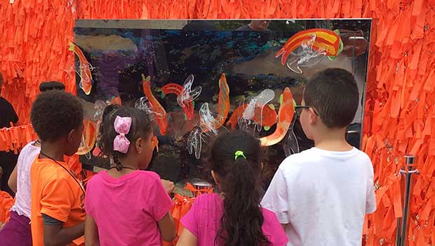Children viewing Color Me Orange—Color Me Kind at ArtPrize Eight