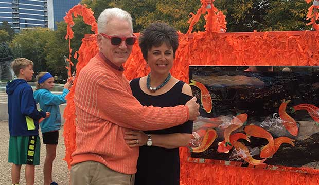 Leon and Pamela with Color Me Orange—Color Me Kind at ArtPrize Eight