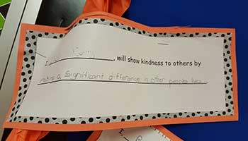 Close-up of kindness promise