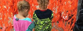Two young girls viewing Color Me Orange—Color Me Kind at ArtPrize Eight
